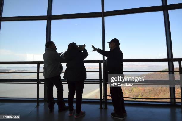 Visitors look towards North Korea from a South Korean observation post in Paju near the Demilitarized Zone dividing the two Koreas on November 14...