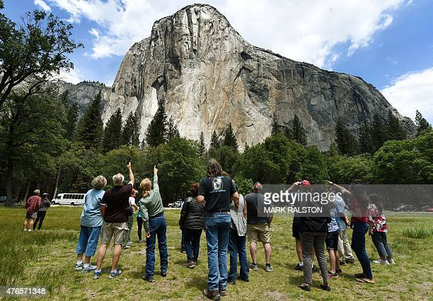 Visitors look up at the El Capitan monolith in the Yosemite National Park in California on June 4 2015 It is one of America's most popular natural...