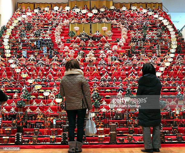 Visitors look up the thirtytiered000 Hinadolls at SekainoMingeiNingyo Museum on January 23 2013 in Suzaka Nagano Japan The dolls usually seventiered...