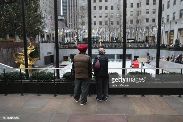 Visitors look upon the ice skating rink at Rockefeller Center on December 12 2017 in New York City Security in the city remained in a hightened state...