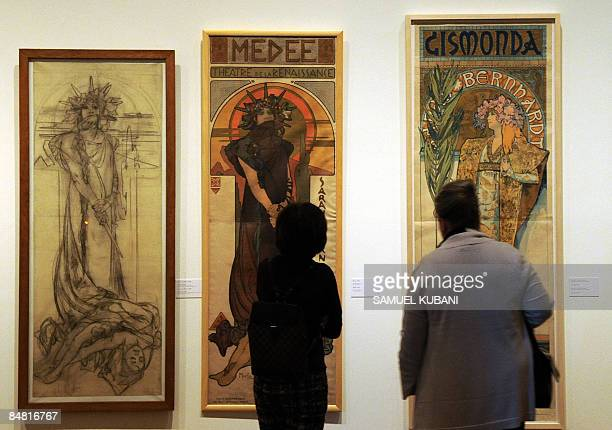 Visitors look works of Czech Art Nouveau artist Alfons Mucha during the opening of the Alfons Mucha exhibition on February 11 2009 at the Belveder...