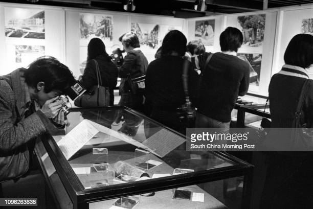 Visitors looking at contents of a time capsule on display at the Hong Kong Museum of History The 80yearold time capsule carrying mostly newspapers...