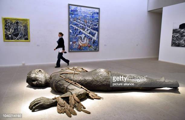 """Visitors looking at the artwork """"Icarus"""" by Stephan Balkenhol at thee Wuerth Collection in Schwaebisch Hall, Germany, 29September 2016. The..."""