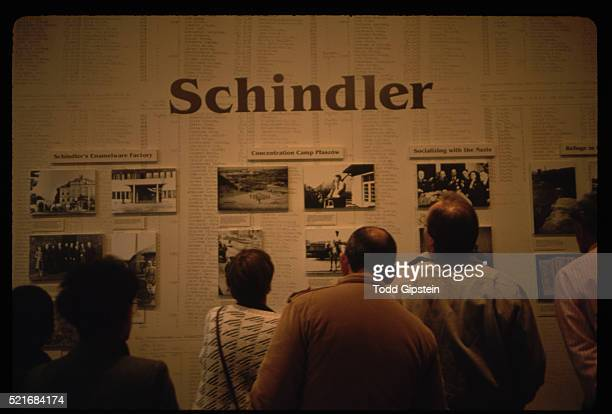 visitors looking at wall dedicated to oskar schindler - oskar schindler stock pictures, royalty-free photos & images