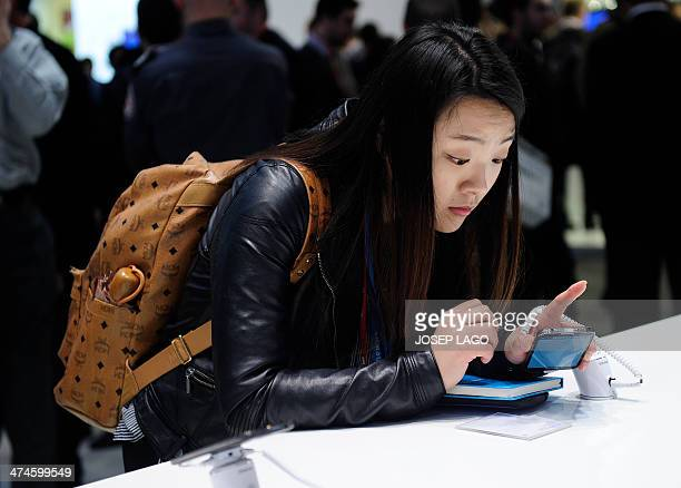 Visitors looks at a Samsung Galaxy S4 at the Mobile World Congress in Barcelona, on February 24, 2014. The Mobile World Congress runs from the 24 to...