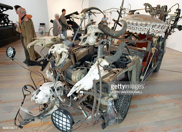 Visitors looks at a sculpture by Jean Tinguely made from an old car at Jean Tinguely Museum in Basel 02 June 2004. The museum, built in 1996 by Swiss...