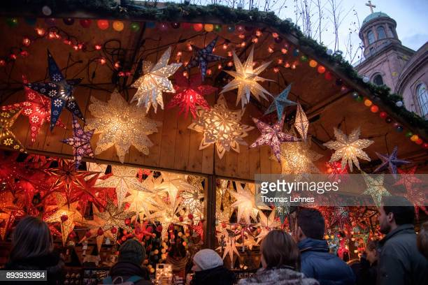 Visitors looks at a stall with Christmas decorations at the annual Christmas market at Roemerberg on December 16 2017 in Frankfurt Germany Christmas...