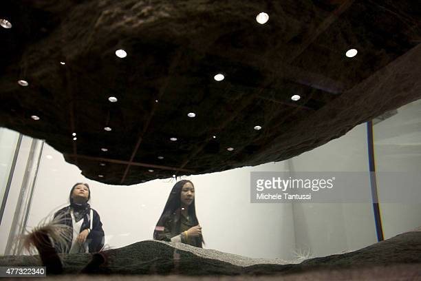 visitors looks at the artwork of the artist Pierre Huyghe Cambrian Explosion during the press preview day at ART Basel on June 16 2015 in Basel...