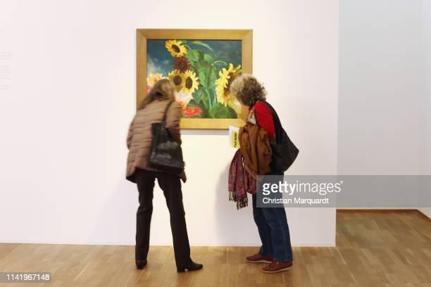 """Visitors looks at the artwork 'Sunflower Picture' during the preview of the exhibition """"Emil Nolde - Eine deutsche Legende. Der Kuenstler im..."""