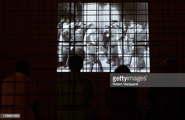Visitors looks at 'The Mexican Suitcase' exhibition at the National Art Museum of Catalunya on October 19 2011 in Barcelona Spain The Exhibition...