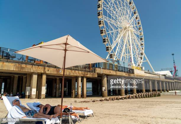 Visitors lounge on the beach on June 29 2018 in Atlantic City New Jersey Two new casinos opened this week in the seaside resort as residents seek an...