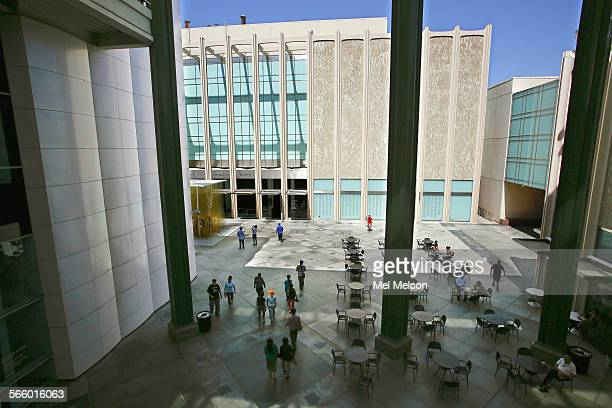 Visitors make their way in the Los Angeles Times via Getty Images Central Court at the Los Angeles County Museum of Art in Los Angeles surrounded by...