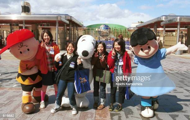 Visitors meet characters from the cartoon 'Peanuts' during a preopening preview of Universal Studios March 29 2001 in Osaka Japan Although the park...