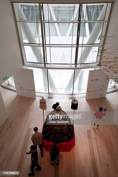 Visitors mill around a large statue of Genghis Kahn in the ArtScience Museum on February 19 2011 at Marina Bay Sands Singapore The ArtScience Museum...