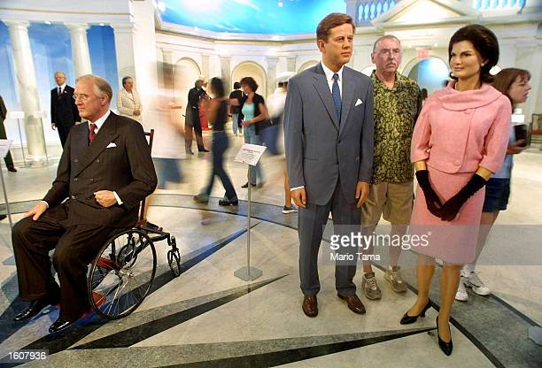 Visitors mingle with wax figures of President Franlin Roosevelt left President John F Kennedy center and Jackie Kennedy Onassis at Madame Tussaud''s...