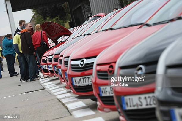 Visitors mostly Opel employees former employees and their family members look at Opel Corsa cars from a local auto club at the Opel Insignia and...