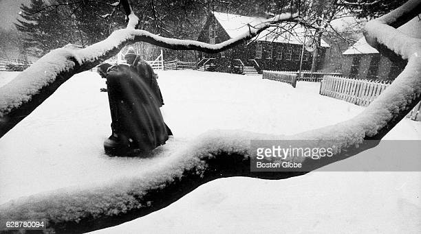 Visitors move through snow at Old Sturbridge Village in Sturbridge Mass 1983 [Date estimated to year]