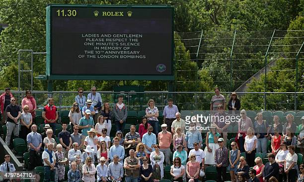 Visitors observe a minute's silence on the 10th anniversary of the July 7th attacks on London ahead of play on day 8 of the Wimbledon Lawn Tennis...