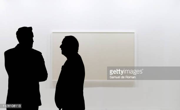 Visitors observe pictures during the 38th International Contemporary Art Fair held in Madrid at Ifema on February 28 2019 in Madrid Spain