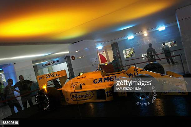 Visitors observe the original Lotus car used by the threetime F1 World Champion late Brazilian Ayrton Senna during the opening of the 'Victory'...