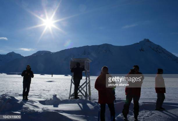 Visitors observe the preparation of a weather balloon before the measurements in NyAlesund Norway 09 April 2015 The measurement data of the ozone and...