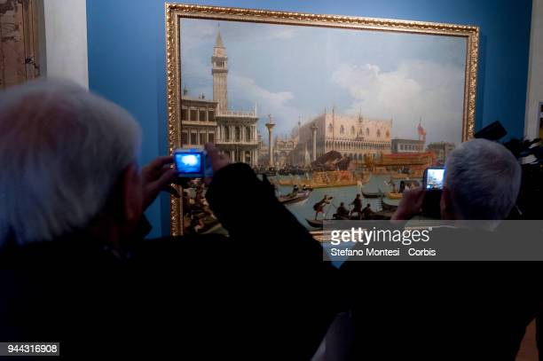 Visitors observes at the oil on canvas painting 'The Bucintoro retuning to the Molo on the Ascension Day' by 18th century Venetian master Giovanni...