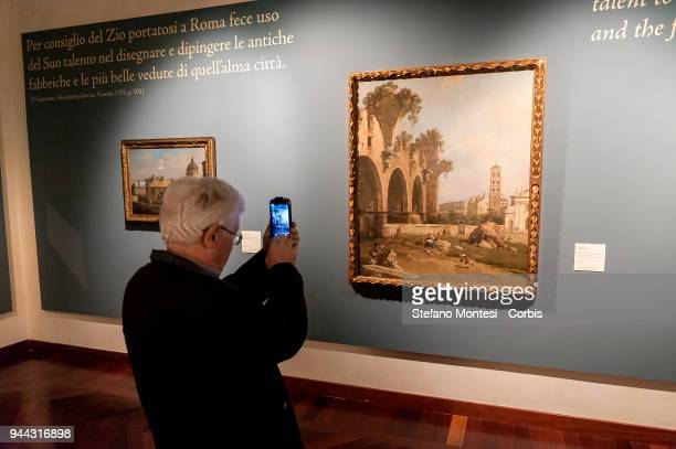 Visitors observes the painting 'The Basilica of Maxentius Santa Francesca Romana and the Colosseum Rome' by 18th century Venetian master Giovanni...