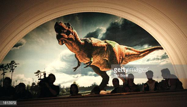 Visitors occupy a balcony at the Field Museum to get a birds-eye view of Sue, the largest and most complete Tyrannosaurus rex ever found May 10, 2000...