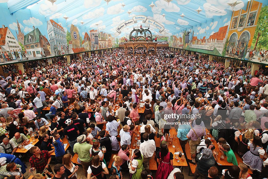 Visitors of a beer tent enjoy the opening day of the Oktoberfest at Theresienwiese on September 18, 2010 in Munich, Germany. 2010 marks the 200th anniversary of Oktoberfest.The Oktoberfest tradition started in 1810 to celebrate the October 12th marriage of Bavarian Crown Prince Ludwig to the Saxon-Hildburghausen Princess Therese. The citizens of Munich were invited to join in the festivities which were held over five days on the fields in front of the city gates. The main event of the original Oktoberfest was a horse race. The world's biggest beer festival will last this year from September 18 to October 4.