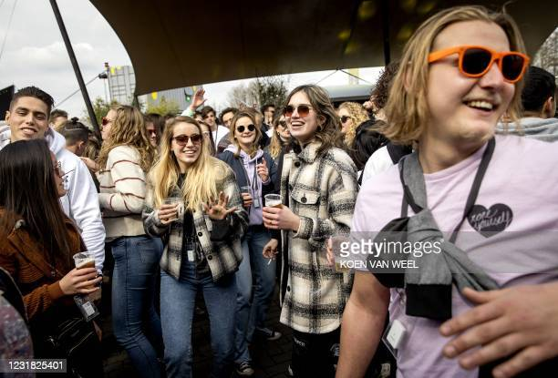 Visitors of a dance festival on the event site of Walibi Holland dance during a performance by Lion Kojo, in Biddinghuizen, Northern Netherlands, on...