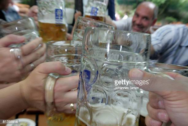 Visitors of the Augustiner beergarden cheer during a warm summer afternoon on May 28 2008 in Munich Germany Visiting beergardens is very popular in...
