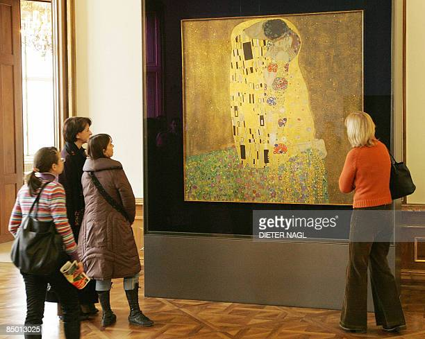 Visitors of the Belvedere Museum watch Gustav Klimt´s painting 'Der Kuss' on February 24 2009 in Vienna Gustav Klimt has finished this painting...