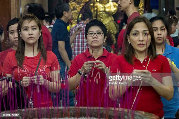 Visitors of the Buddhist Temple in Tondo Manila offer their worship and prayers in front of an altar in one of the shrines inside the temple