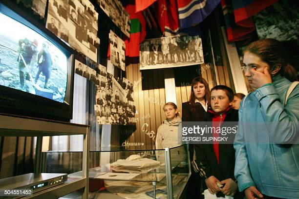 Visitors of the Chernobyl catastrophe museum in Kiev look at a documentary film about the liquidators the some 600000 front lines soldiers firemen...