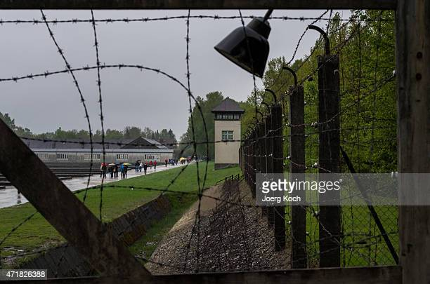Visitors of the Dachau concentration camp attend the former camp site on May 1 2015 in Dachau Germany Dachau was the first Nazi concentration camp...