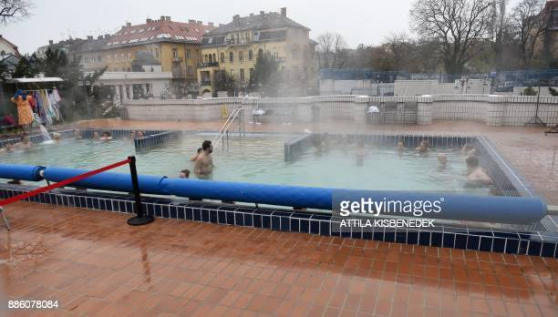 Visitors of the Gellert Bath enjoy the thermal water in Budapest on a cold December 3 2017 / AFP PHOTO / ATTILA KISBENEDEK