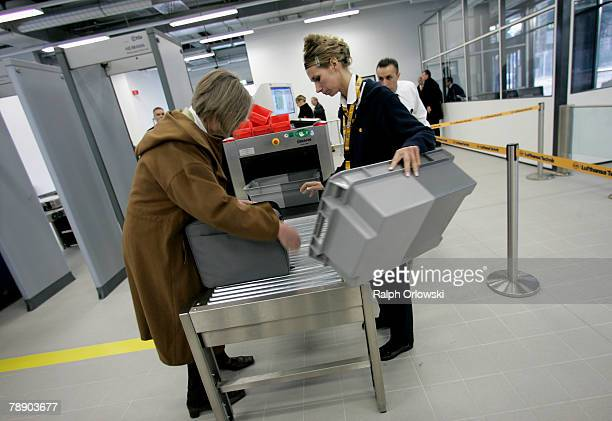 Visitors of the inauguration ceremony of the Airbus A380 hangar at Frankfurt airport are checked January 11 2008 in Frankfurt Germany Lufthansa that...