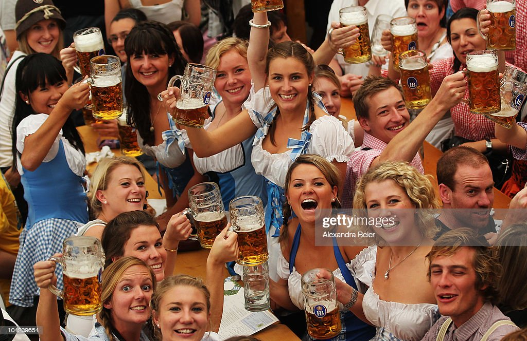 Visitors of the Oktoberfest toast with beer mugs during the opening day of the Oktoberfest at Theresienwiese on September 18, 2010 in Munich, Germany. 2010 marks the 200th anniversary of Oktoberfest.The Oktoberfest tradition started in 1810 to celebrate the October 12th marriage of Bavarian Crown Prince Ludwig to the Saxon-Hildburghausen Princess Therese. The citizens of Munich were invited to join in the festivities which were held over five days on the fields in front of the city gates. The main event of the original Oktoberfest was a horse race. The world's biggest beer festival will last this year from September 18 to October 4.