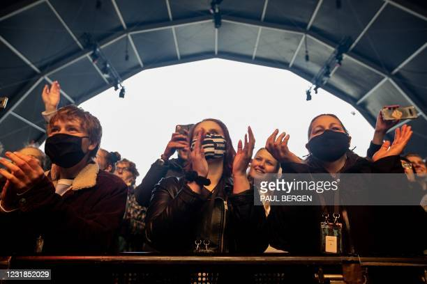 """Visitors of the pop festival """"Back To Live"""" on the event site of Walibi Holland dance during a performance by Froukje Veenstra, in Biddinghuizen,..."""