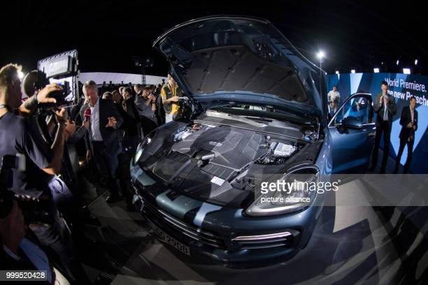 Visitors of the premiere look at the car model during the introduction of the new Cayenne Generation at the Porsche Museum in Stuttgart Germany 29...