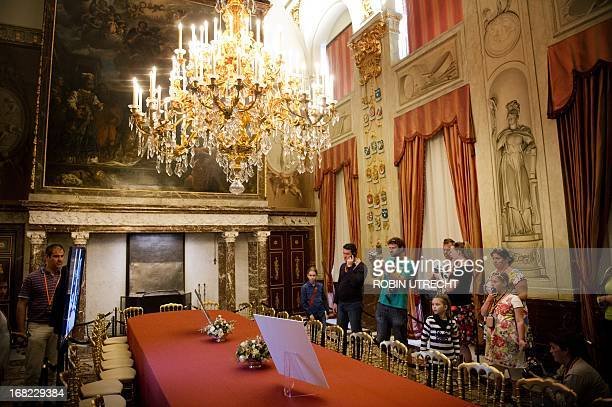 Visitors of the Royal Palace on Dam look at the interior of the Vroedschapskamer in Amsterdam on May 7 2013 The palace was closed to the public for a...