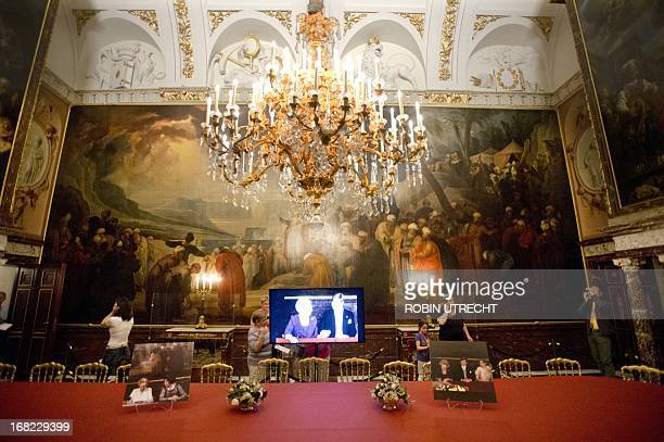Visitors of the Royal Palace on Dam look at the interior of the Vroedschapskamer in Amsterdam on May 7, 2013. The palace was closed to the public for...