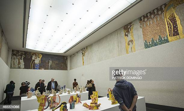 Visitors of the Secession Museum stand in a hall where the socalled Beethoven Frieze Painting entitled 'Kiss to the Whole World' by Austrian painter...