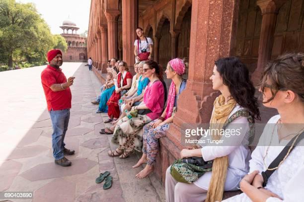 visitors on a tour at the Taj Mahal