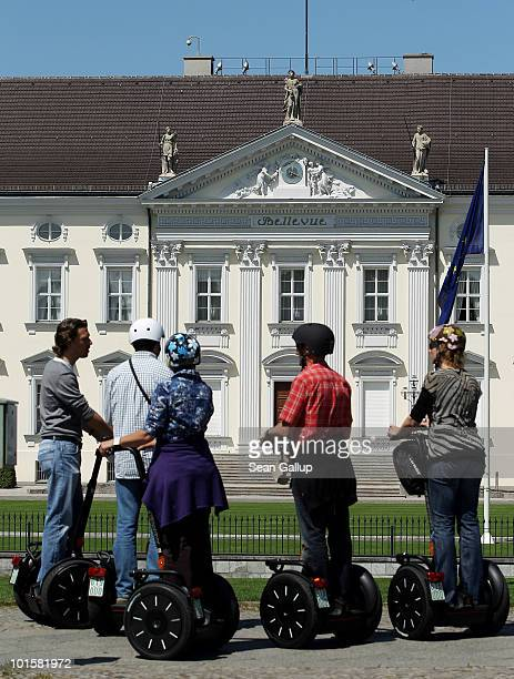 Visitors on Segway personal transporters stop to look at Schloss Bellevue which serves as the German presidential palace on June 3 2010 in Berlin...