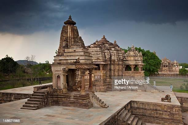 Visitors on steps of Devi Jagdamba Temple alongside Portico of the Mahadeva Temple.