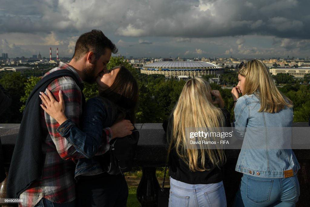 Visitors on Vorobyovy Hills enjoy the view of the Luzhniki stadium ahead of the Russia 2018 FIFA World Cup semi-final match between England and Croatia on July 9, 2018 in Moscow, Russia.