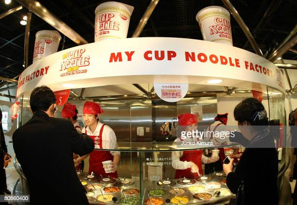 Visitors order their own cup noodle at the Instant Ramen Museum on April 8 2008 in Osaka Japan It has been fifty years since Momofuku Ando founder of...