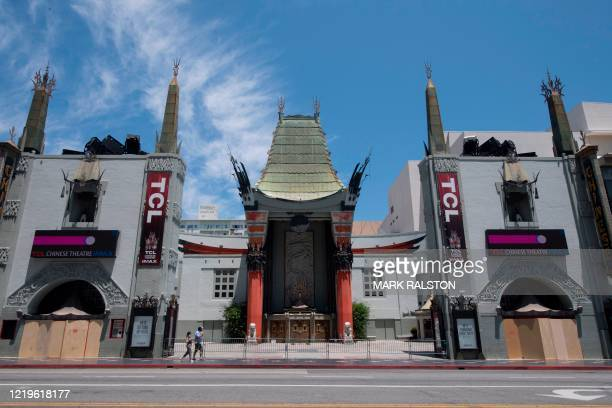 Visitors outside the iconic TCL Chinese Theater which is closed due to the Covid19 virus on Hollywood Blvd Hollywood California on June 12 2020...