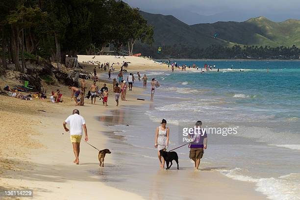 Visitors pack Kailua Beach park December 26 2011 in Kailua Hawaii US President Barack Obama is spending the Christmas holiday in his native Hawaii...